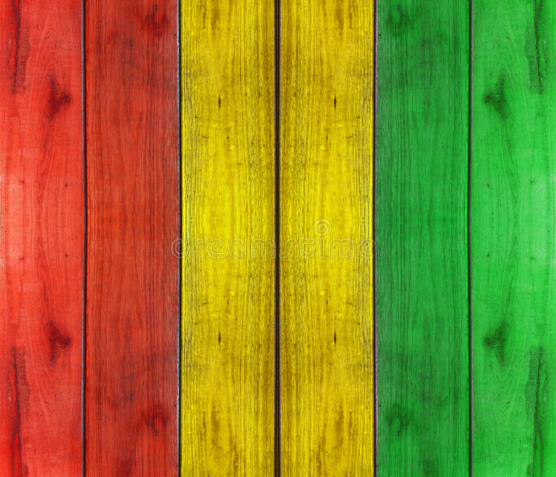 Wooden plank with reggae colour background stock images