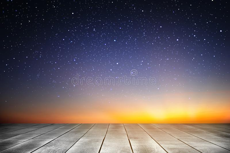 Wooden plank and starry night background in the sunrise time. Wooden plank and starry background in the sunrise time stock images
