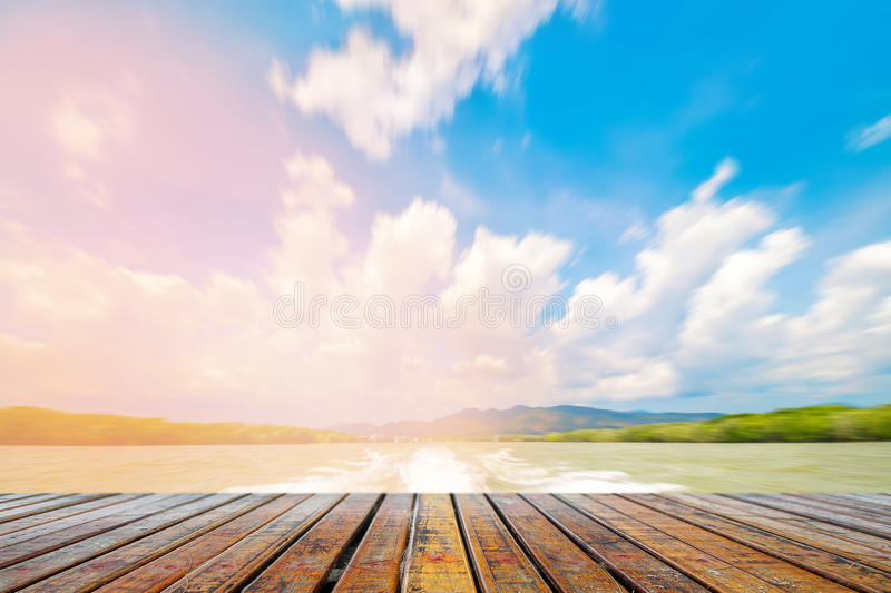 Wooden plank under picture of wave with tree at nature royalty free stock images