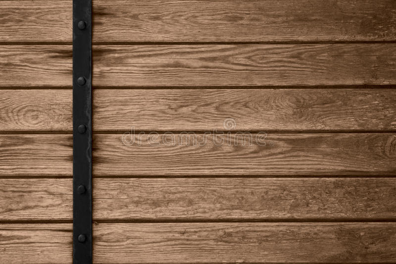 Wooden planks background with black metal bar stock photos