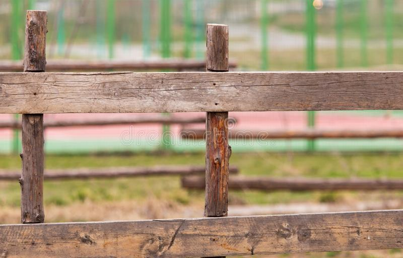 Wooden planks on the fence in the park stock photography