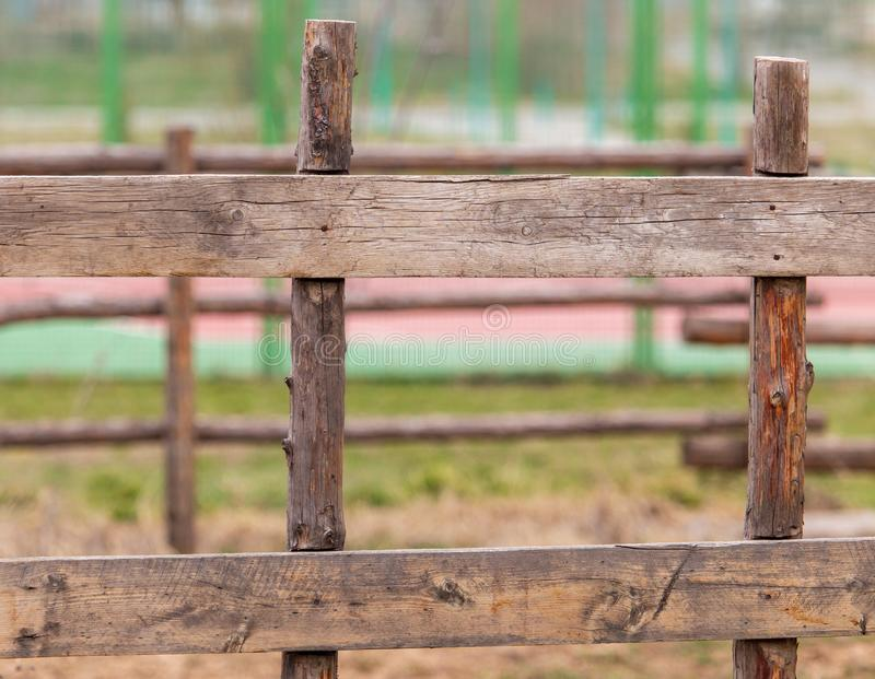 Wooden planks on the fence in the park royalty free stock photos