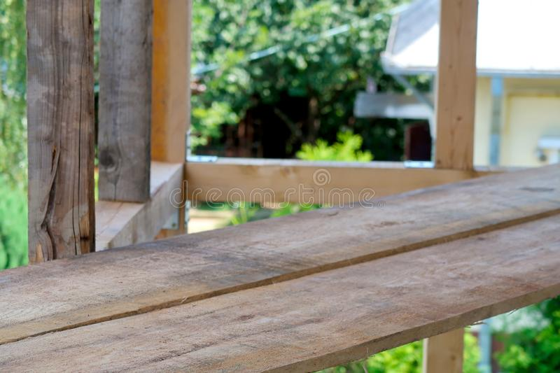 Wooden planks in focus on a construction site stock photography