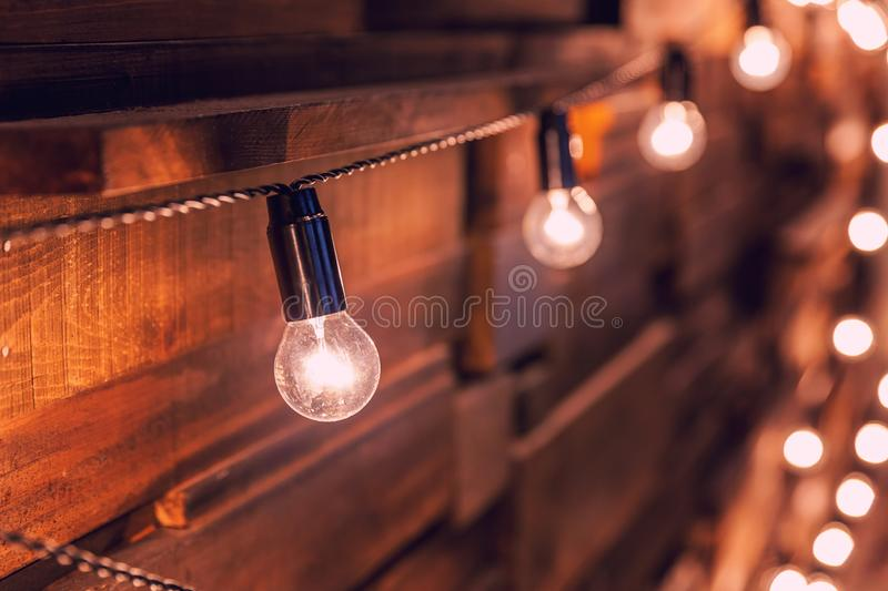 Wooden planks with lamps background. Decorated interior room with gold lights stock photo