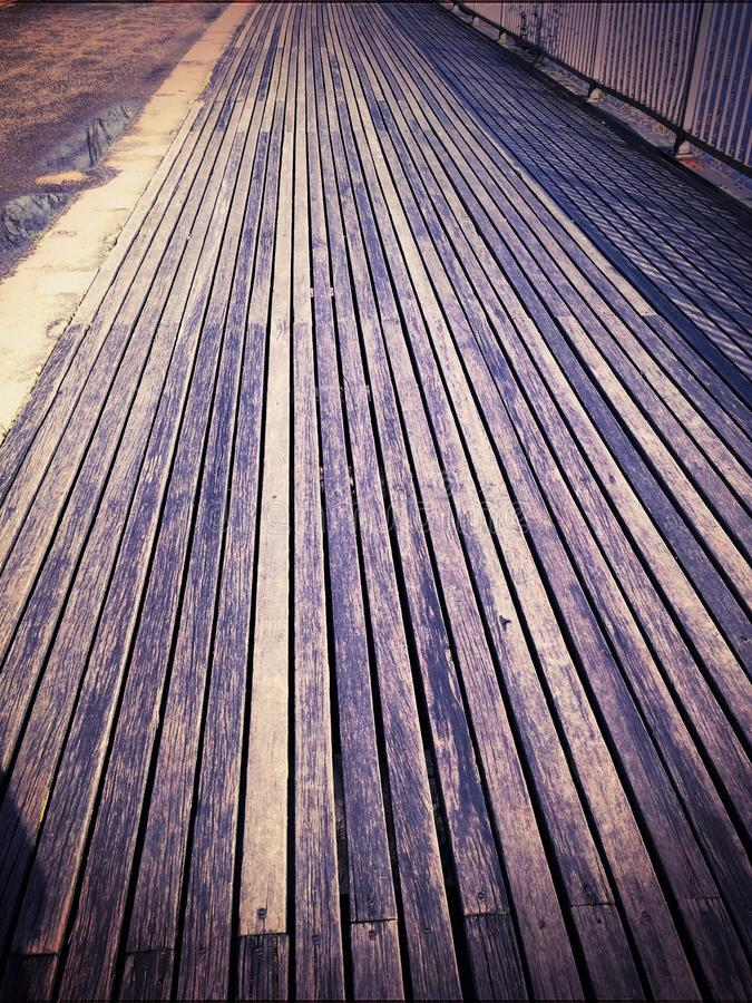 Wooden planks. Lines of parallel wood on a walkway on the floor royalty free stock photos
