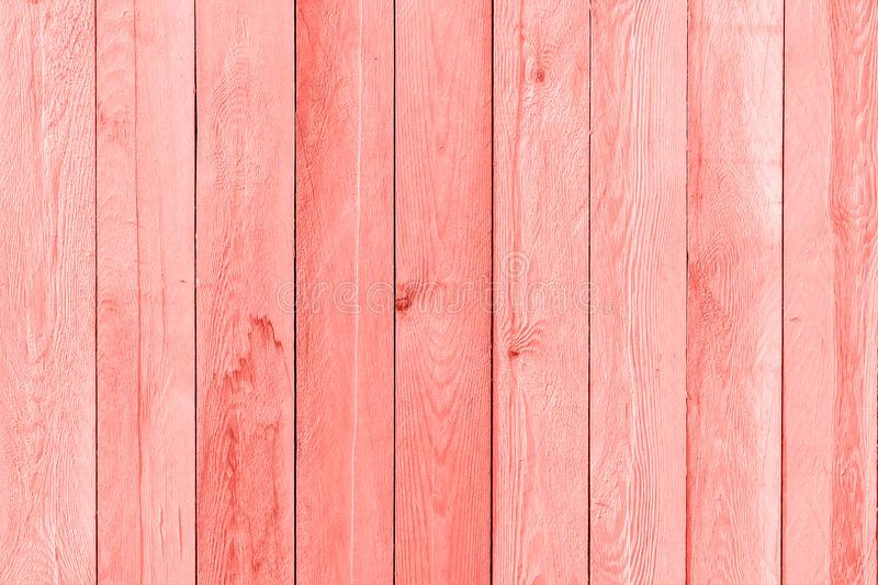 Wooden planks painted trendy coral color of the year 2019, background, texture stock photography