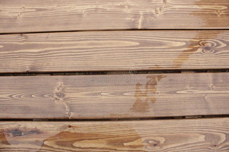 The wooden planks in the rain stock images