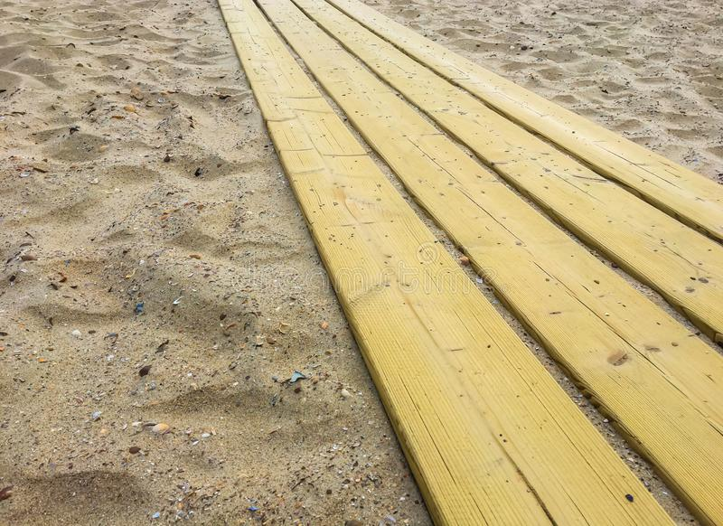 Wooden planks walking path in a beach landscape close up background texture stock photos