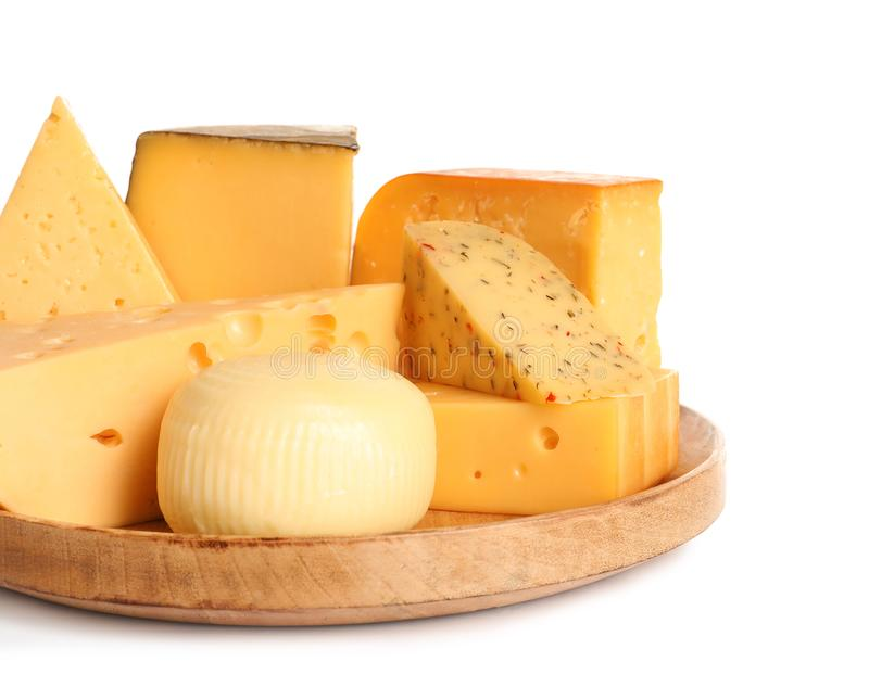 Wooden plate with different kinds of cheese on white. Background stock photos