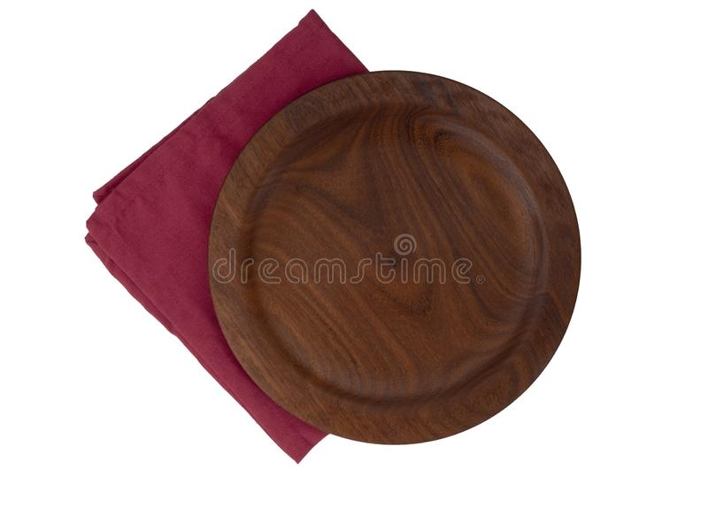 Wooden plate on red fabric napkin, serviette, isolated on white background. Top view. Wooden plate on red fabric napkin, serviette, isolated on white background royalty free stock images