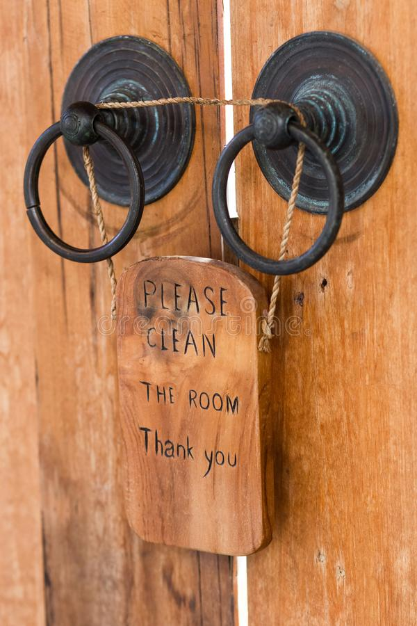 Wooden plate with sign Please clean the room on vintage door. Wooden plate with sign Please clean the room on vintage wooden door royalty free stock photos
