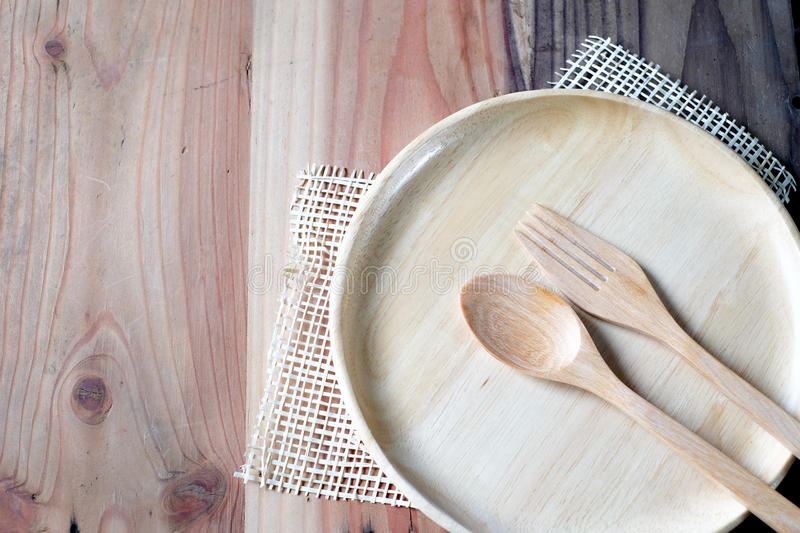 The wooden plate on a wood table stock photography