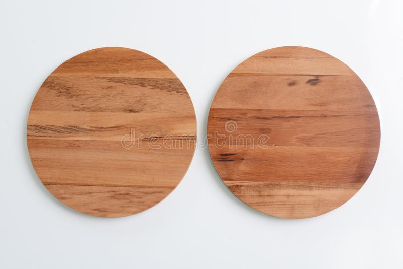 Wooden plates. Isolated on white background stock photos