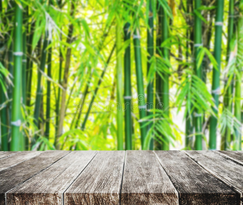 Wooden platform and Asian Bamboo forest with morning sunlight stock images