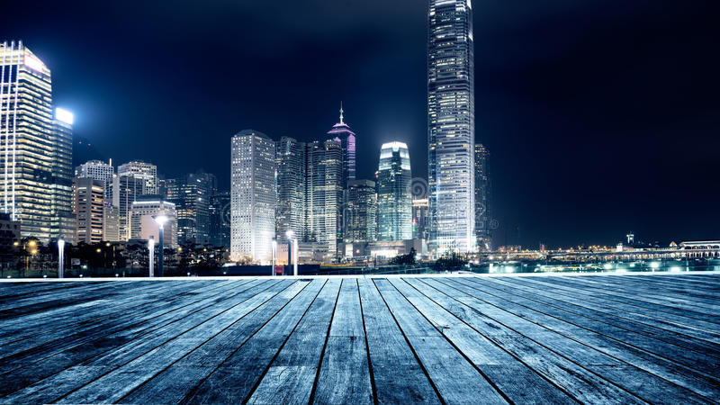 Wooden platform and city stock photo