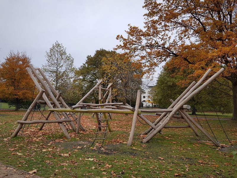 Wooden playground equipment in park. Autumn, season, outdoor, activity, childhood stock images