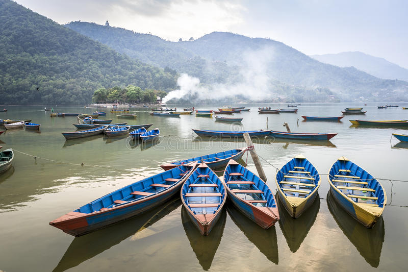 Wooden pleasure boats on Fewa Lake in Pokhara stock photos