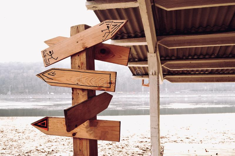 Wooden pointer on the beach. Direction arrows on the beach royalty free stock photography
