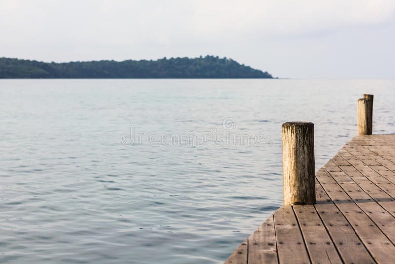 Wooden pole pire on the sea stock photos