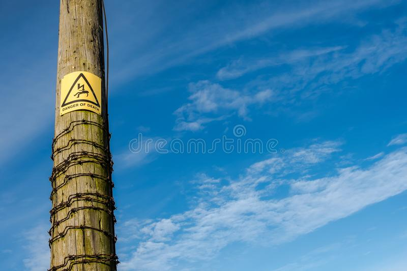 Electrical Power Pole Showing Danger Of Death Warning And Barbed ...