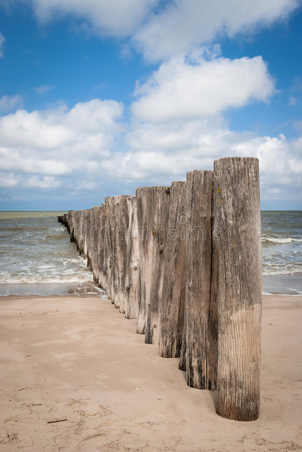 Wooden Poles in the beach in Pas de Calais, France. The Strait of Dover or Pas de Calais is the strait at the narrowest part of the English Channel, marking the stock photo