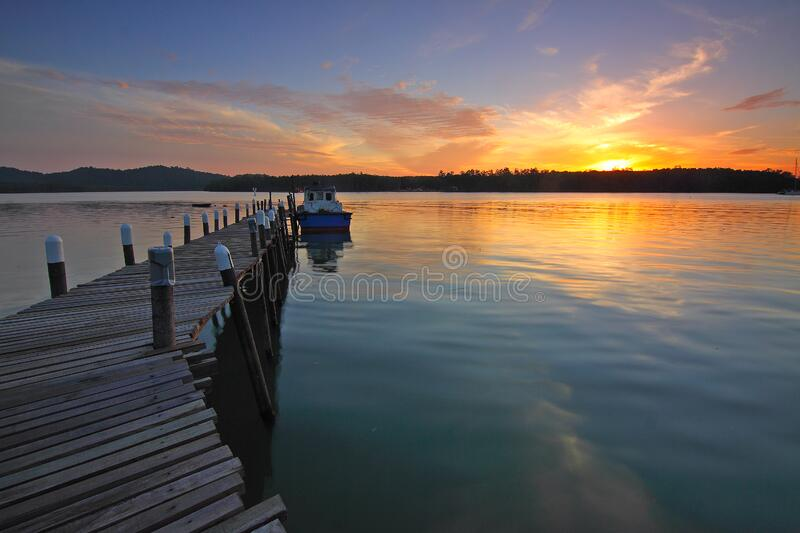 Wooden pontoon at sunset royalty free stock image