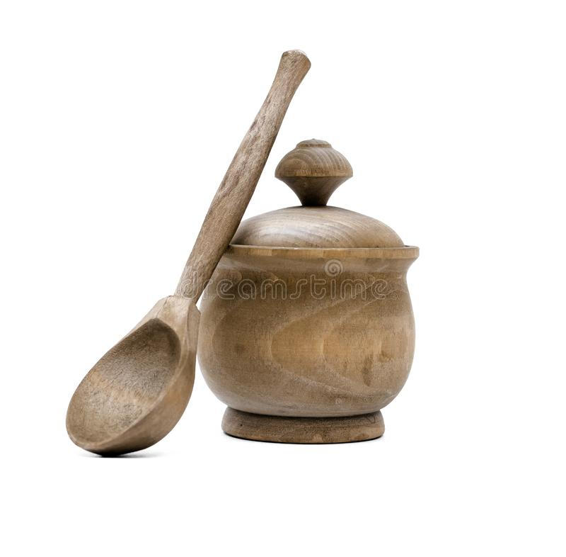 Wooden pot with wood spoon. Crockery. Wooden pots with wood spoon isolated on white background royalty free stock photo