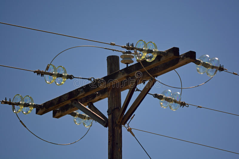 Wooden Power Pole with Antique Glass Insulators on a Sunny Day royalty free stock photos