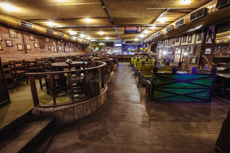 Wooden pub interior. Kiev, Ukraine- March 19, 2018. Irish pub without people. expensive wooden interior as a background. place for text royalty free stock images