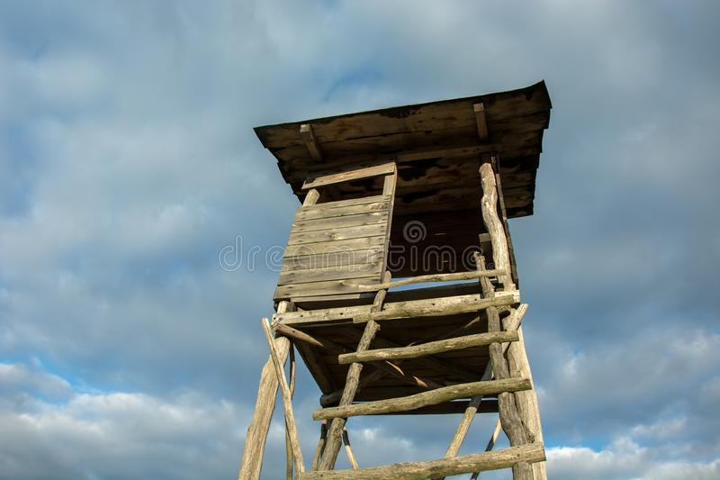 Wooden pulpit for hunters and sky royalty free stock photos