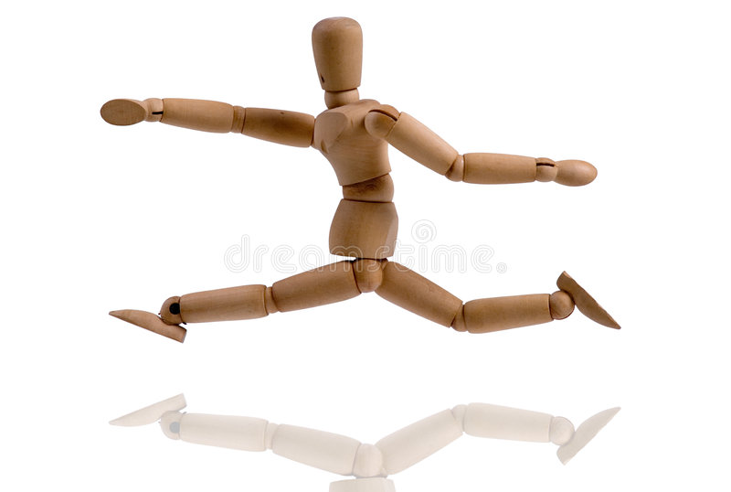 Wooden puppet. A running wooden puppet over white royalty free stock photography