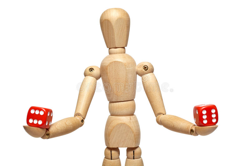 Wooden puppet with dice. Wooden puppet holds dice on white background with clipping path stock photography