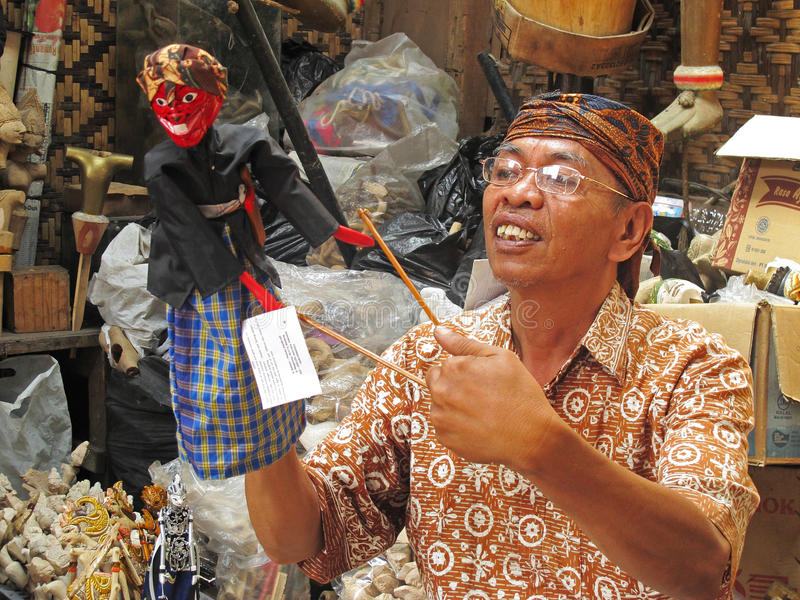 Wooden puppet maker. In Bandung, Indonesia. Wayang golek are wooden doll puppets that are operated from below by rods connected to the hands and a central royalty free stock photos