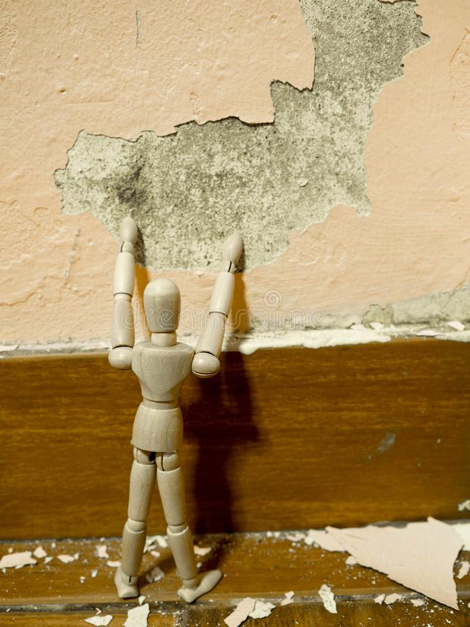 Wooden Puppet Tried To Fix Old Paint Peeling Plaster Walls Damage ...