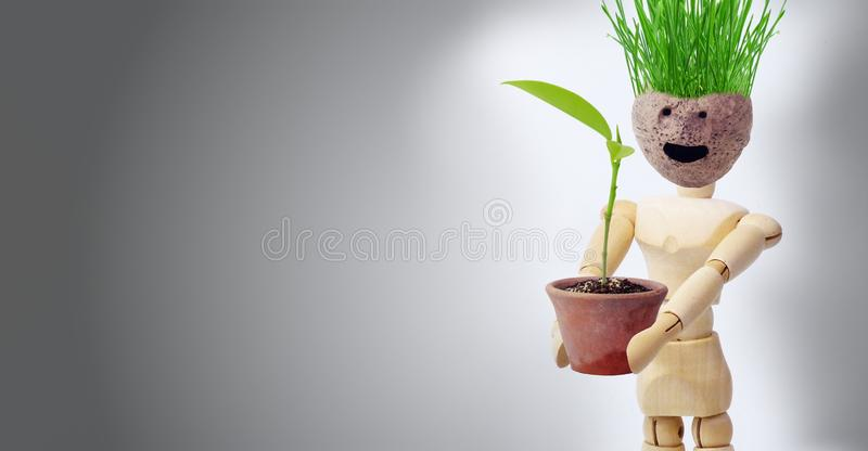 Wooden puppets that show gestures related to planting trees. To reduce global warming royalty free stock photos