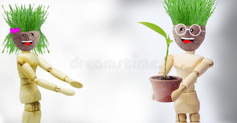 Wooden puppets that show gestures related to planting trees. To reduce global warming stock image