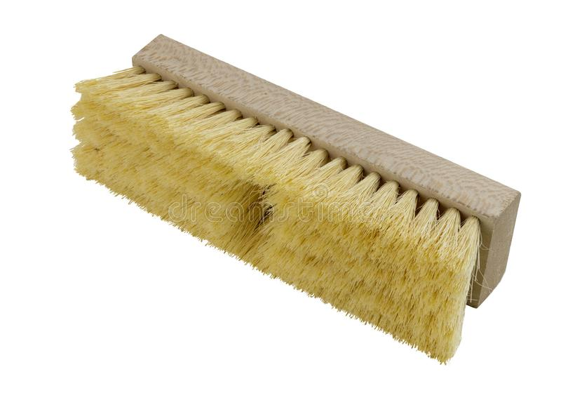 Wooden push broom head with yellow bristles stock photography