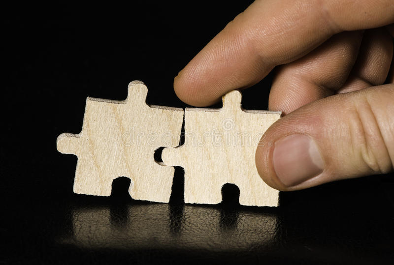Wooden puzzle on black background. Close up royalty free stock photos