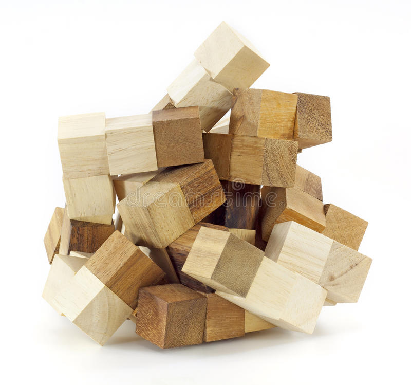 Wooden puzzle block game. On white background stock images