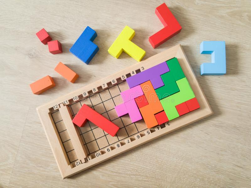 Wooden puzzle blocks toy. Color wooden puzzle blocks toy on a floor stock photos