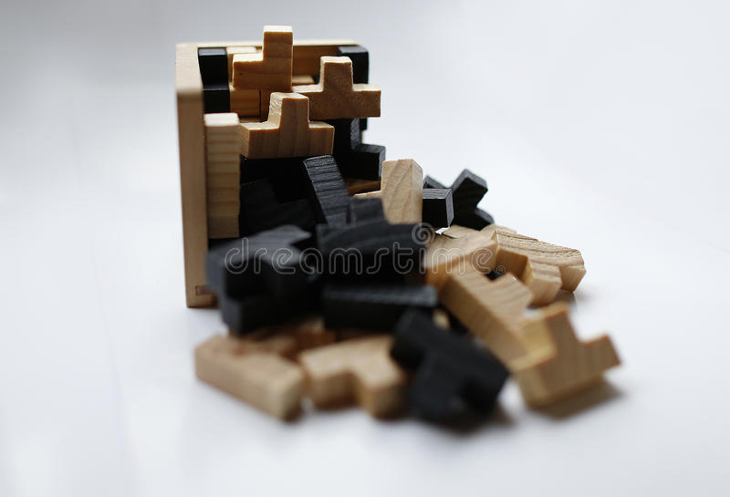 Wooden puzzle blocks on white background. With shadow stock image