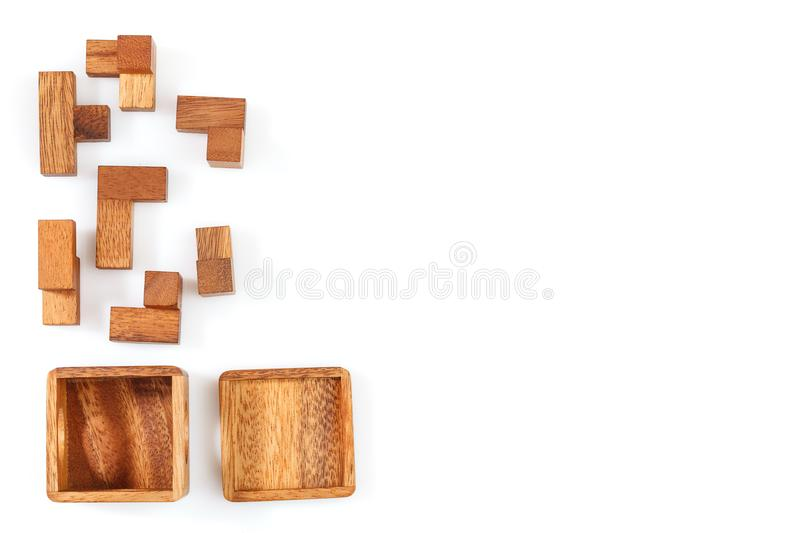 A wooden puzzle is a cube. Isolated on white background. Close-up. A wooden puzzle is a cube, logical game. Isolated on white background. Close-up royalty free stock image