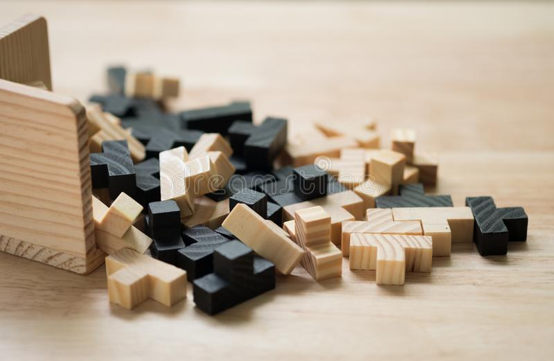 Wooden puzzle game. Closeup image of building wooden puzzle game stock photography