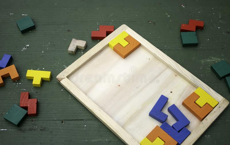 Wooden puzzle pieces stock photo