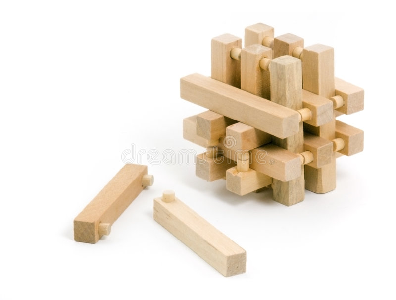 Wooden Puzzle with Two Pulled Pieces royalty free stock photography