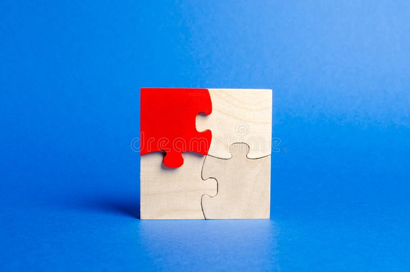 Wooden puzzles on a blue background. One puzzle is different. Individual opinion. Stand out from the crowd. Uniqueness. Divergent royalty free stock images