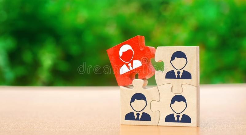 Wooden puzzles with the image of workers. The concept of personnel management in the company. Dismissing an employees from a team. Demotion. Bad worker. Staff stock image