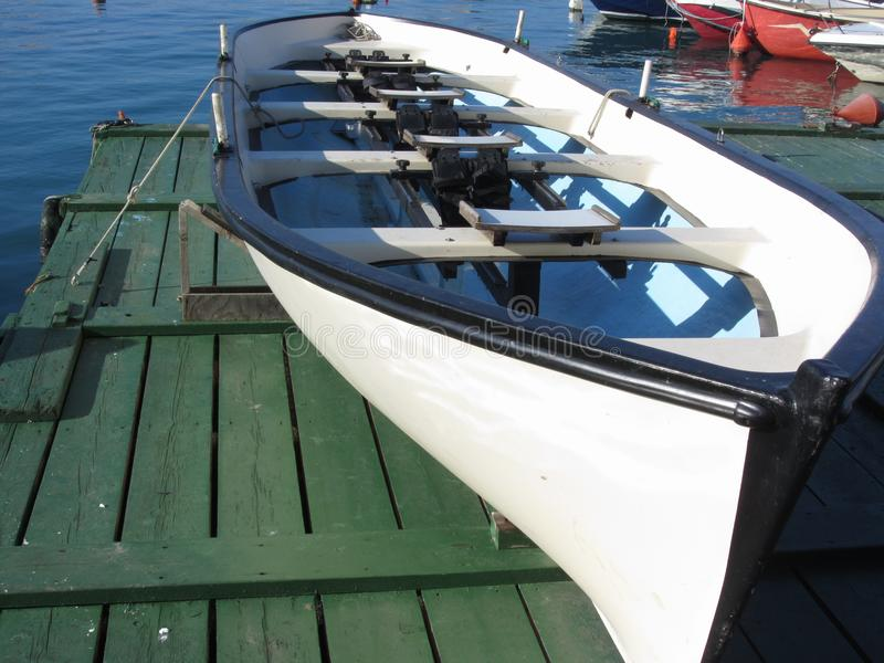 Wooden racing boat with four seats under repair in dry dock . Livorno, Tuscany, Italy.  royalty free stock photo