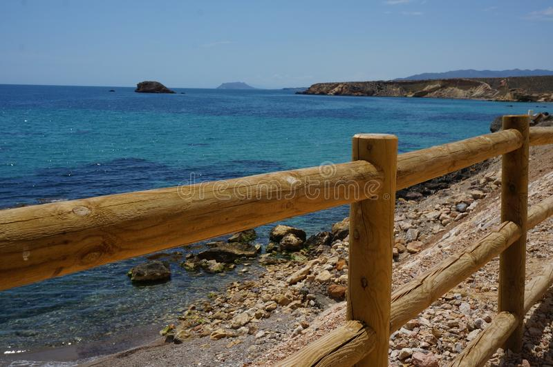 Wooden railing on the coast of the Mediterranean sea royalty free stock photography