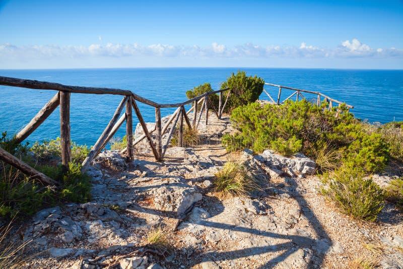 Wooden railing on coast of Mediterranean sea royalty free stock photography